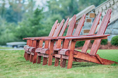 Two wooden adirondack chairs Royalty Free Stock Photography