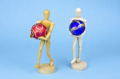 Two wooden artist manikin with christmas baubles stock photo