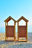 Two wooden beach changing rooms. On a beautiful beach of northern Greece Stock Images