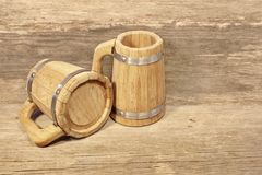 Two Wooden Beer Mug and Rough Timber Background Stock Images