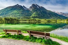 Two wooden bench at the Hintersee lake in the Alps Royalty Free Stock Photography