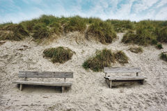 Two Wooden benches at the seaside Royalty Free Stock Photography
