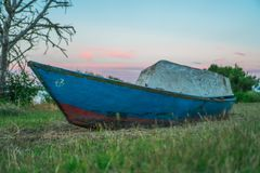 Two wooden boats abandoned in the middle of nature stock photography