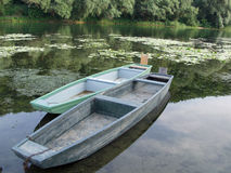Two wooden boats in a lake Royalty Free Stock Images
