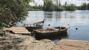 Two wooden boats on the stream, Cuba stock video