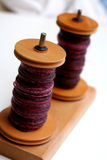 Two wooden bobbins with yarn Stock Photography