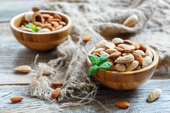 Two wooden bowls with almonds. Royalty Free Stock Photography