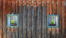 Two wooden box windows of a rustic wooden house Stock Photography