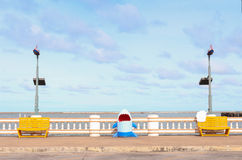 Two wooden chair on the Sea. Two yellow wooden chair and shark on the Sea Stock Photos