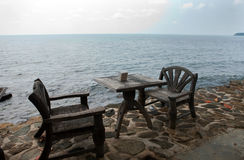 Two wooden chairs on the beach Stock Photos