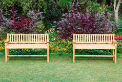 Two wooden chairs in the park Royalty Free Stock Photo