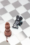 Two wooden chess pieces Royalty Free Stock Image