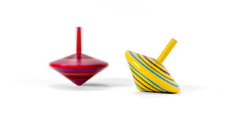 Two wooden and colorful spinning tops Royalty Free Stock Image