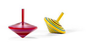Two wooden and colorful spinning tops Stock Photos