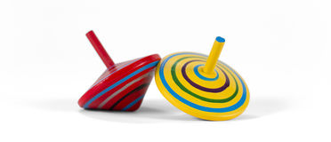 Two wooden and colorful spinning tops Stock Photography