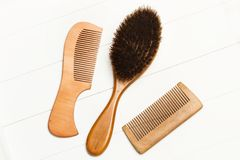 Two wooden combs and a hairbrush. In a cut out view Royalty Free Stock Photos