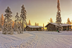 Two wooden cottages at winter Lapland Stock Photo