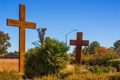 Two Wooden Crosses Against Blue Sky Background Stock Image