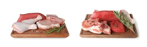 Two wooden cutting boards with different kinds of raw meat. On white background stock photography