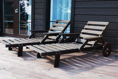 Two wooden deck chairs on the terrace Stock Images