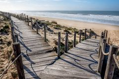 Free Two Wooden Decking Pathways Forming A Fork In The Road Both Heading Down To A Sandy Beach Stock Image - 144290921