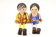 Two wooden doll holding hand Stock Photo