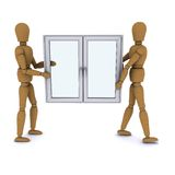 Two wooden doll worker carry a plastic window Royalty Free Stock Photo
