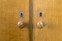 Two wooden door handles and keyholes Royalty Free Stock Photos