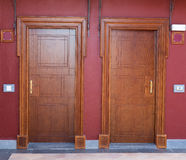 Two wooden doors of the hotel. Stock Images