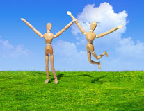 Two wooden figures stock photos