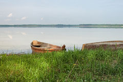 Two wooden fishing boats on bank of the lake. Spring landscape photo. Lake Svityaz. Volyn region. Ukraine Royalty Free Stock Image