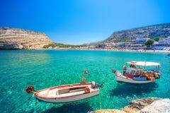 Two wooden fishing boats at Matala, Crete, Greece. royalty free stock image