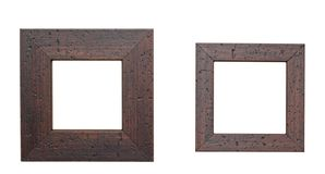 Two wooden frames. Two vintage style wooden frames for pictures over white background Royalty Free Stock Photography