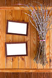 Two wooden frames with bunch of willow. Card for greetings or invitations with two wooden frames and bunch of willow stock photography