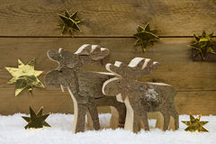 Two wooden handmade reindeer for christmas decoration with natur Stock Photos