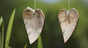 Two wooden hearts royalty free stock image