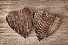 Two wooden hearts Stock Images