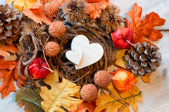 Two Wooden Hearts in Autumn Foliage Nest Royalty Free Stock Images