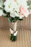 Two wooden hearts with bow on wedding bouquet Stock Photography