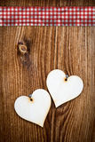 Two wooden hearts on dark wooden planks Stock Photography