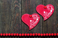 Two wooden hearts with ornament Royalty Free Stock Photo
