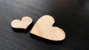 Two wooden hearts placed nicely on a turquoise vintage wood background Stock Photos