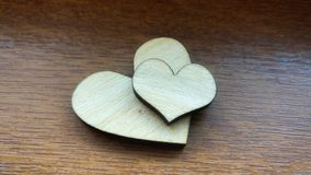 Two wooden hearts placed nicely on a turquoise vintage wood background Stock Photo
