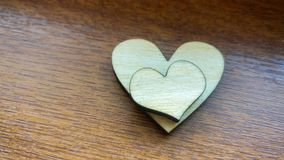Two wooden hearts placed nicely on a turquoise vintage wood background Royalty Free Stock Photography