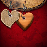 Two Wooden Hearts on Red Floral Background Stock Image