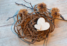 Two Wooden Hearts in Rope Nest Stock Image