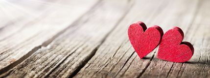 Two Wooden Hearts On Rustic Table stock photography