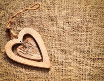 Two wooden hearts on sackcloth, canvas background. Vintage style. Royalty Free Stock Photos