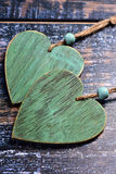 Two wooden hearts on shabby background Royalty Free Stock Photography