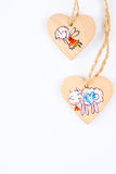 Two wooden hearts on string forming Christmas pattern Royalty Free Stock Images